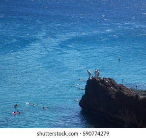 People Jumping from Black Rock into the Pacific Ocean in Maui Hawaii