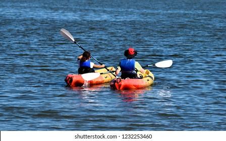 People kayaking at the ocean beach St. Augustine, Florida