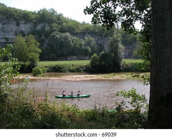 People kayaking on a river
