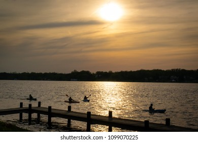 People kayaking on a spring evening with sunset on the Niagara River near Buffalo, N.Y.