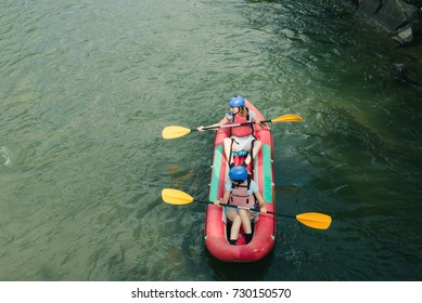 People kayaking, or rafting on mountain river. Adventure sport on boats, top view