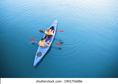 People kayaking in river, top view