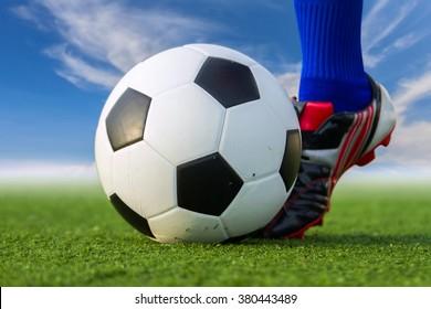 People kick soccer ball.