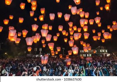 People launching asian sky lanterns during Lanterns festival at Pingxi, Taiwan