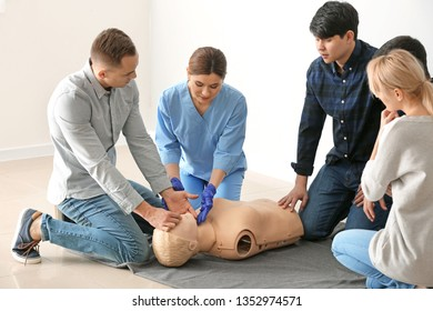 People learning to perform CPR at first aid training course