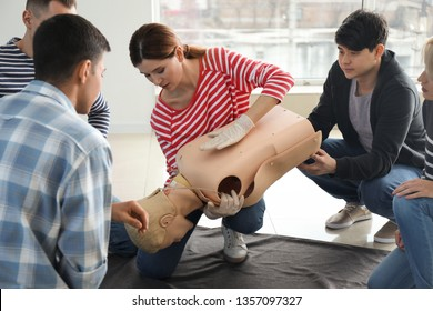 People learning to provide first aid at training course