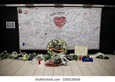 People leave flowers on Monument for the victims of the Brussels attacks in Maalbeek metro station  to pay tribute to the victims of the Brussels terror attacks on Mar. 22, 2017.