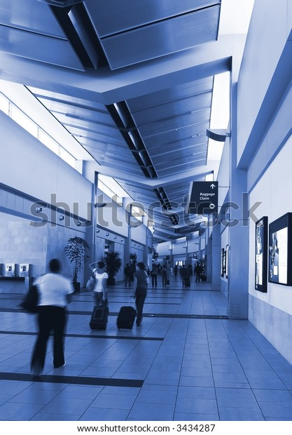 People leaving the airport gate area. Blue monochrome