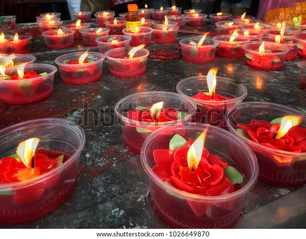 People light up red flower candle for brightness life in the beginning of their Chinese New Year at Chinese temple.