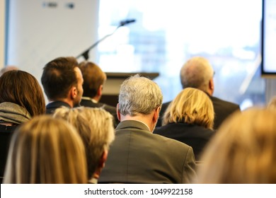 People listening to a panel discussion at a networking event in Washington, D.C.