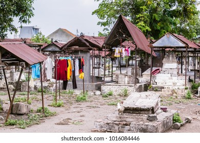 People living on an ancient Dutch cemetery from the colonial times in Peneleh, Surabaya, Java island, Indonesia
