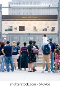 People looking at the 9/11 timeline in NYC