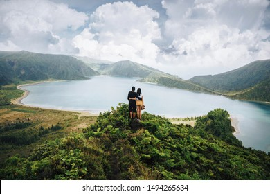 people looking at amazing mountains and forest, wanderlust travel concept, space for text, atmospheric epic moment, azores ,portuhal, ponta delgada, sao miguel
