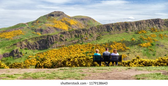 People looking at Arthur's Seat and Salisbury crags - view from Calton hill at Edinburgh, Scotland