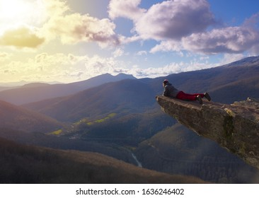 People looking at the landscape at the edge of the cliff of the Zamariain viewpoint, Pyrenees of Navarra, Spain