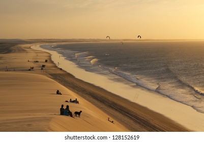 People looking at the sunset on a sand dune in Jericoacoara in Brazil