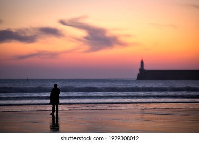 people looking at a vivid sunsetat les sables d'olonne beach - Shutterstock ID 1929308012