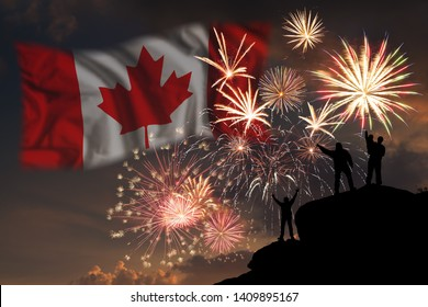 People looks holiday fireworks on independence day of Canada, flag in sky
