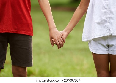 Boy and Girl Holding Hands Images, Stock Photos & Vectors