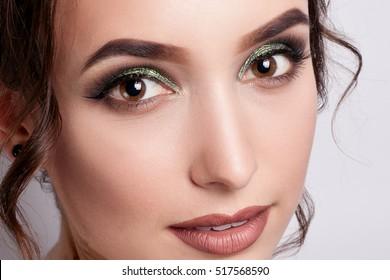 people, luxury, make-up and fashion concept - Glamorous female portrait close up. Makeup emerald green, long eyelashes, perfect skin