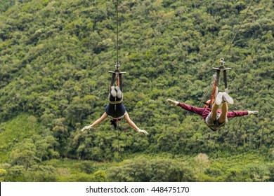 People making canopy, and extreme touristic activity hanged on wire at highs in Banos, Ecuador