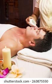 people man engaged in Ayurvedic spa treatment