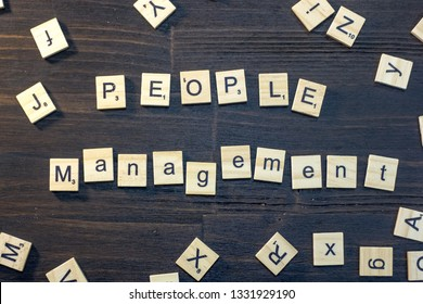 people management word made with scrabble letters.