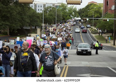 People marching down 11th Street during the March for Science in Austin, Texas on Saturday April 22, 2017.