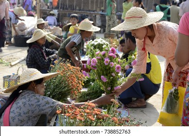 People at the Market at the Village of Phaung Daw Oo at the Inle Lake in the Shan State in the east of Myanmar in Southeastasia, myanmar, inle lake, april, 2015..