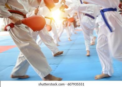 People in martial arts training exercising Taekwondo. blur motion