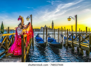 people in masks and costumes on Venetian carnival