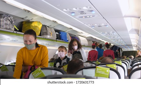 People with masks get on airplane. Passengers wearing surgical mask to prevent infection from coronavirus. Thailand, Bangkok, 13 april 2020
