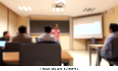 people in a master class with a coach business. blurred background