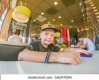 People in McDonalds. Mcdonalds Restaurant. Mcdonald's Corporation Is World's Largest Chain Of Hamburger Fast Food Restaurants. Krasnogorsk Moscow region Russia July 2019
