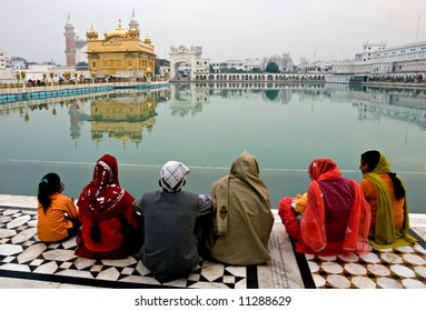 People meditating at the golden temple.