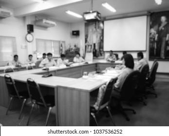 people in meeting room, blur image