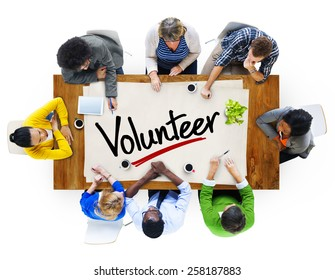 People in a Meeting and Single Word Volunteer Concept