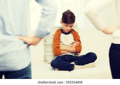 people, misbehavior, family and relations concept - close up of upset or feeling guilty boy and parents at home