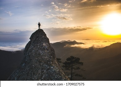 People in the mountains against the backdrop of nature