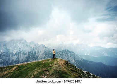 people in mountains, background alps, wonderful travel concept, space for text, atmospheric epic moment