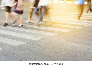 People are moving across the crosswalk on the city road, Close-up crosswalk