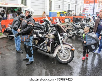 People near motorcycles. St. Petersburg, Russia - 5 August, 2017. The annual Harley-Davidson Festival is held in the center of St. Petersburg.