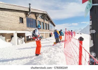 People near the ski shelter. Sochi, Russia - 1 January, 2017. Winter mountain ski resort Rosa Khutor.