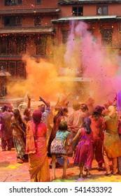 People in Nepal celebrating holi festival in spring in Bhaktapur