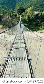 People in Nepal mostly across the river by Suspension bridge  in rural area.