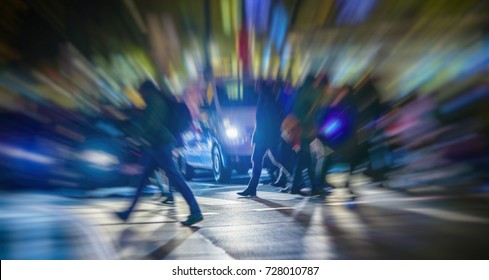 people and night traffic in the city