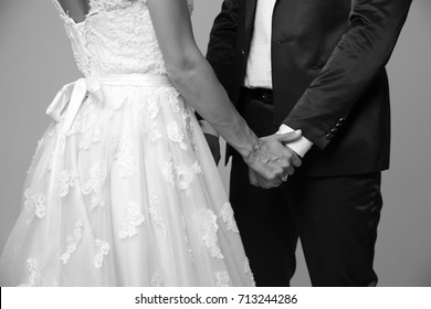 People no face. Black and white photo of a closeup loving couple on a wedding day. Black and white photo body without face. Wedding couple of bride and groom.