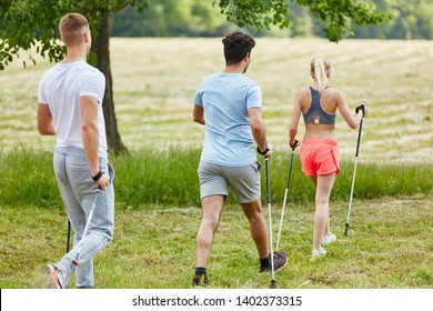 People nordic walking in the nature with persistence in their hiking tour
