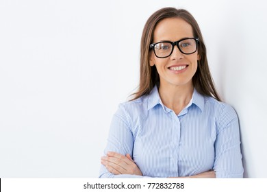 people, office and vision concept - close up of happy smiling middle aged businesswoman in glasses