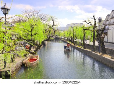 People in old-fashioned boat, Kurashiki canal in Bikan district, Kurashiki city, Japan